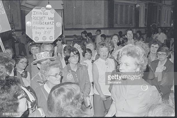 Phyllis Schlafly of Alton Illinois talks with other Equal Rights Amendment opponents in the capital rotunda June 2 Earlier Senator James Taylor...