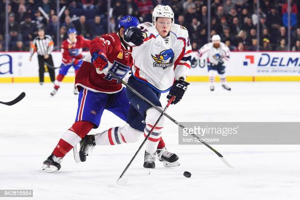Springfield Thunderbirds right wing Owen Tippett battles with Laval Rocket defenceman Trevor Owens for control of the puck during the Springfield...