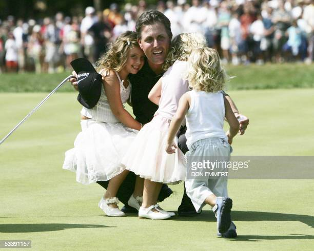 CORRECTIONPhil Mickelson of the US is joined by his children Amanda Sophia and Evan after his winning putt on the 18th green at Baltusrol Golf Club...