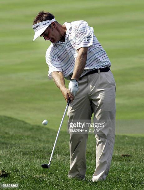 Springfield, UNITED STATES: Stuart Appleby of Australia hits out of the fairway on the 1st hole during the first round of the 87th PGA Championship...