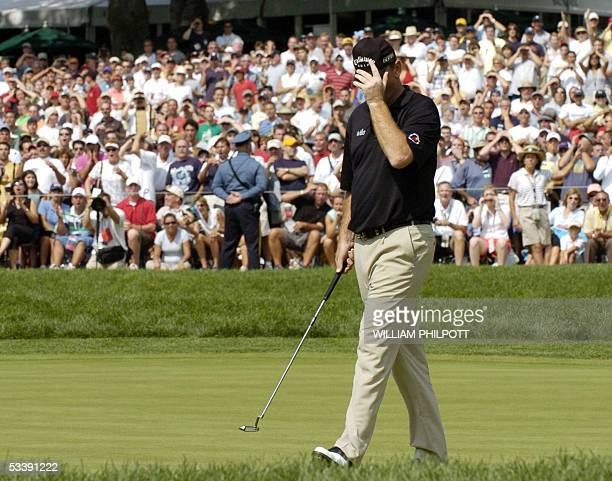 Springfield, UNITED STATES: Thomas Bjorn of Denmark reacts after missing his putt on the 18th green during the final round of the 87th PGA...