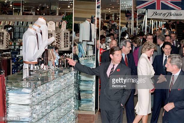 Springfield VA Prince Charles and Princess Diana view a display of British fashions at the JC Penney store in suburban Washington DC