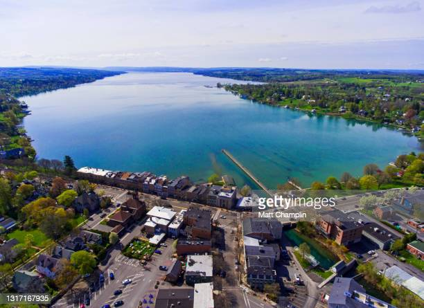springtime aerial of wealthy lakeshore village - skaneateles lake stock pictures, royalty-free photos & images