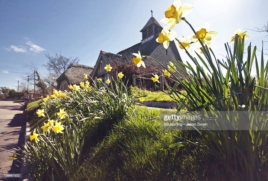 Springtime at St Agnes Thatched Church, IOW : Stock Photo