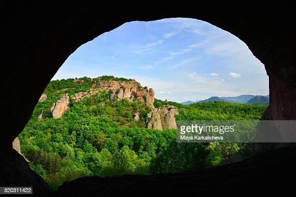 Springtime Belogradchik rocks framed from the inside of a cave