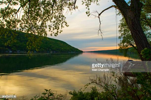 springtime evening on the lake shore - finger lakes stock pictures, royalty-free photos & images