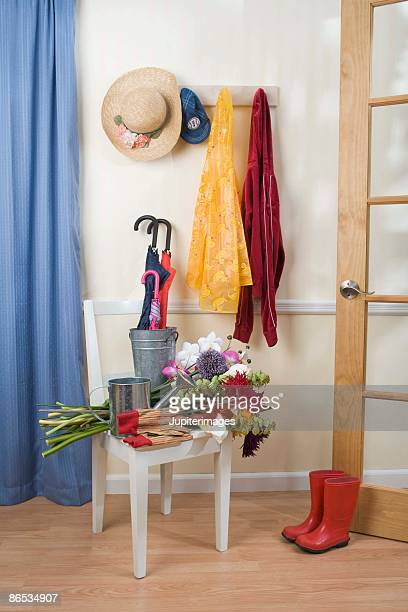 Springtime flowers with gardening boots and straw hat