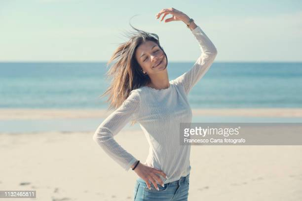 springtime on the beach - one young woman only stock pictures, royalty-free photos & images