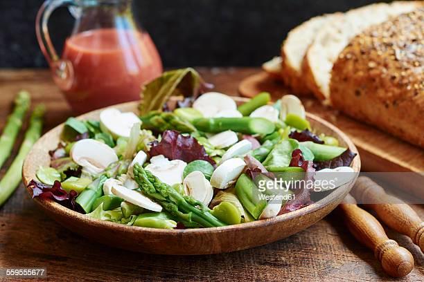 Springtime salad with asparagus, fava beans and mushrooms served with a rhubarb vinaigrette