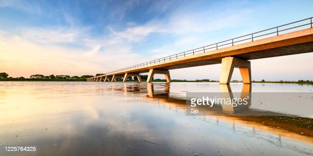 "springtime sunset over a bridge over a lake during a beautiful evening in may - ""sjoerd van der wal"" or ""sjo"" stock pictures, royalty-free photos & images"