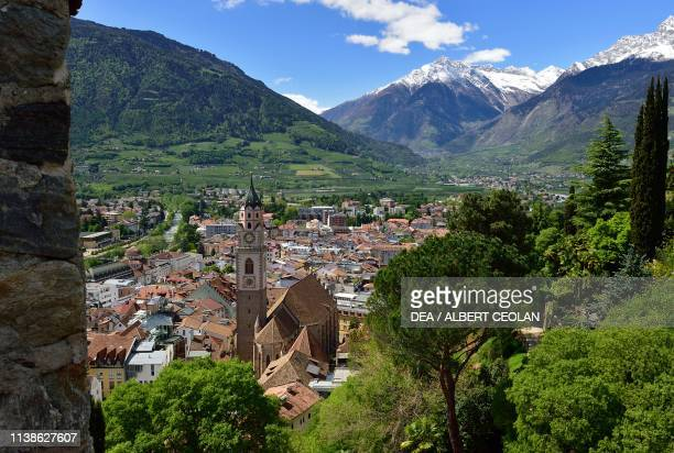 Springtime view from the Tappeiner Promenade over the Church of San Nicolo and the city of Merano with the Venosta Valley in the background,...