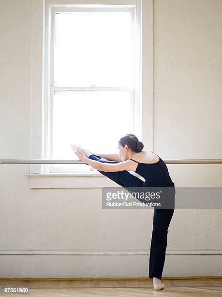 Springville, Utah, USA, Ballet dancer (12-13) stretching