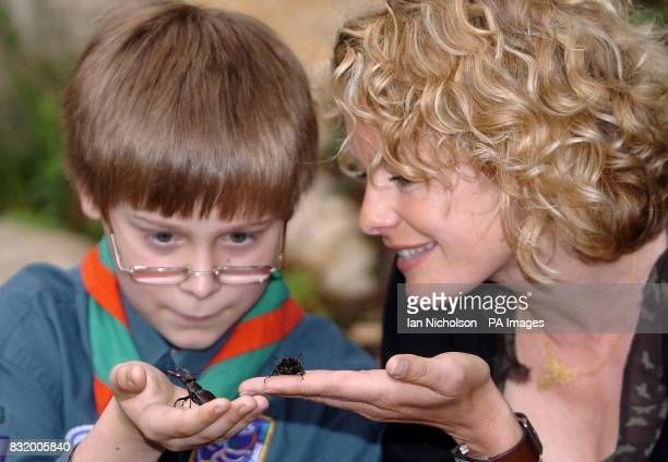 BBC Springwatch presenter Kate Humble and 11yearold Christopher Pearce from Harpenden handle Stag Beetles at the launch today of National Insect Week...