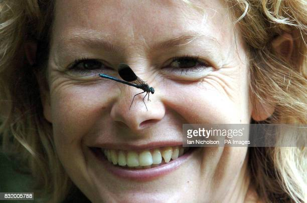 BBC Springwatch presenter Kate Humble poses with a Banded Demoiselle damselfly at the launch today of National Insect Week at London's Natural...