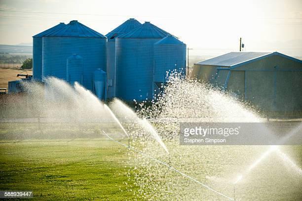 sprinklers and fertilizer storage bins