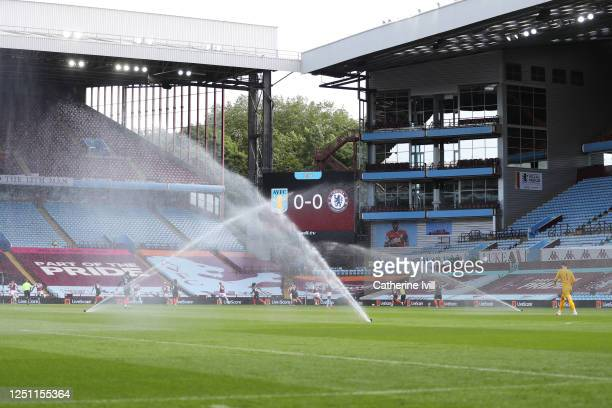Sprinklers turn on during the match during the Premier League match between Aston Villa and Chelsea FC at Villa Park on June 21 2020 in Birmingham...