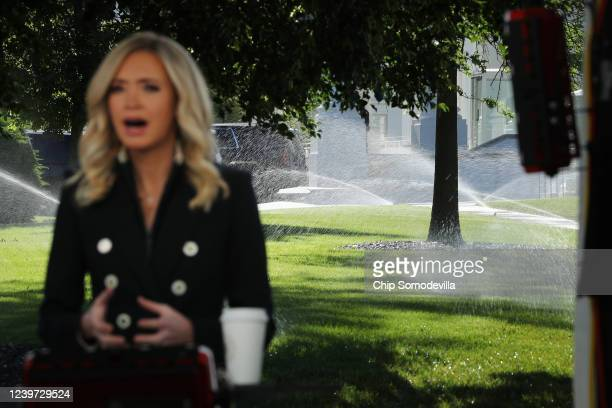 Sprinklers water the North Lawn of the White House as Press Secretary Kayleigh McEnany is interviewed for the Fox & Friends program June 01, 2020 in...