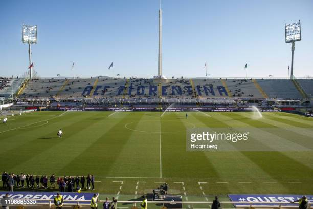 Sprinklers water the pitch ahead of the ACF Fiorentina v SPAL Italian Serie A soccer match at the Artemio Franchi stadium in Florence Italy on Sunday...