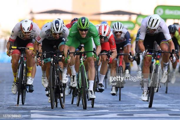 Sprint / Arrival / Alexander Kristoff of Norway and UAE Team Emirates / Peter Sagan of Slovakia and Team Bora - Hansgrohe / Sam Bennett of Ireland...