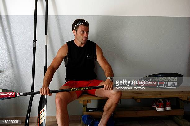 Sprint canoer Antonio Rossi in the canoes hangar holds a paddle and gets ready for a training session on the lake of Pusiano Province of Lecco Italy...