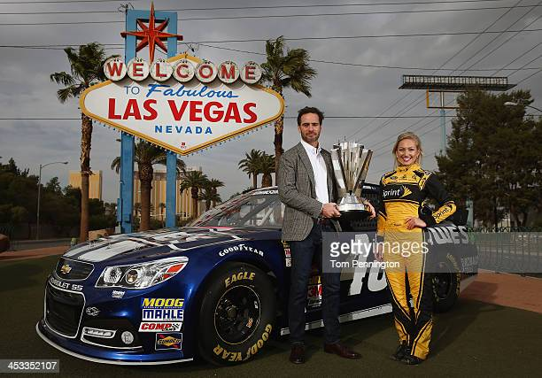 Sprint Cup Champion Jimmie Johnson driver of the Lowe's Chevrolet and Miss Sprint Cup Brooke Werner pose for a photo at the 'Welcome to Fabulous Las...