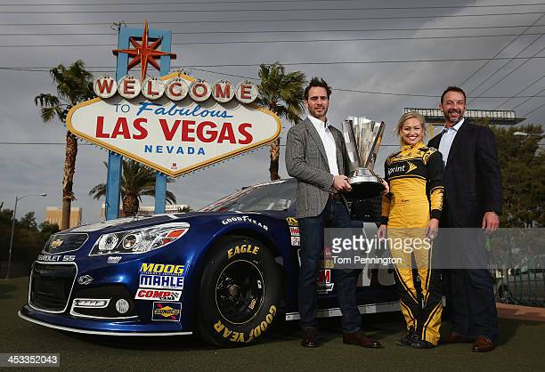 2013 NASCAR Sprint Cup Champion Jimmie Johnson driver of the Lowe's Chevrolet Miss Sprint Cup Brooke Werner and crew chief Chad Knaus pose for a...