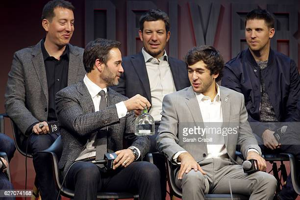 Sprint Cup Champion Jimmie Johnson hands a bottle of Patron Silver Tequila to Chase Elliott during the NASCAR Sprint Cup Trophy during NASCAR After...