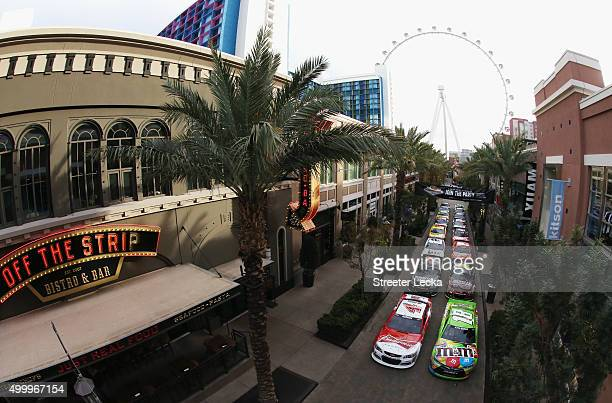 Sprint Cup Series cars are seen in front of the High Roller ferris wheel at The LINQ Hotel Casino on December 4 2015 in Las Vegas Nevada
