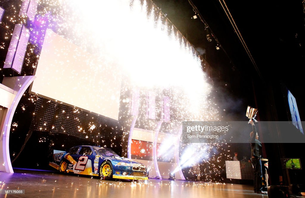 Sprint Cup Series Champion Brad Keselowski, driver of the #2 Miller Lite Dodge, celebrates on stage with the Sprint Cup Championship trophy during NASCAR After The Lap at PH Live at Planet Hollywood Resort & Casino on November 29, 2012 in Las Vegas, Nevada.