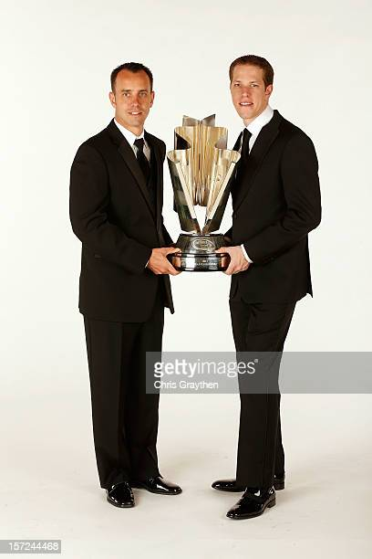 Sprint Cup Series Champion Brad Keselowski driver of the Miller Lite Dodge and his crew cheif Paul Wolfe hold the championship trophy as they pose...