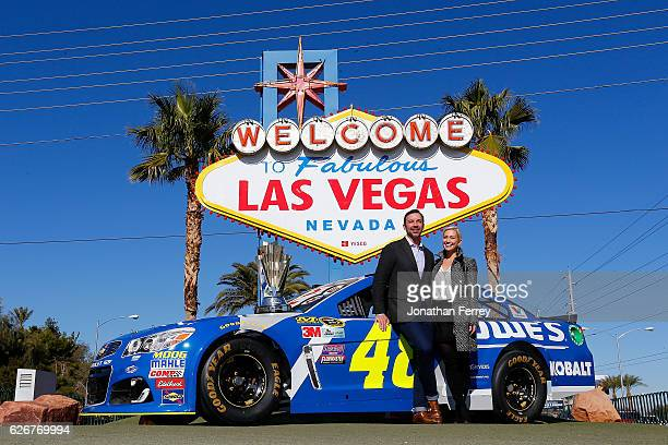 Sprint Cup Series champion crew chief Chad Knaus and Brooke Werner pose in front of the Welcome to Fabulous Las Vegas sign during NASCAR Champion's...