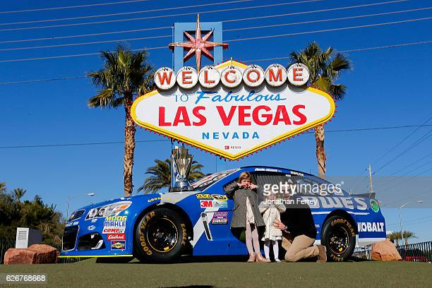Sprint Cup Series champion Jimmie Johnson along with his daughters Genevieve Marie and Lydia Norriss pose for a photo in front of the Welcome to...