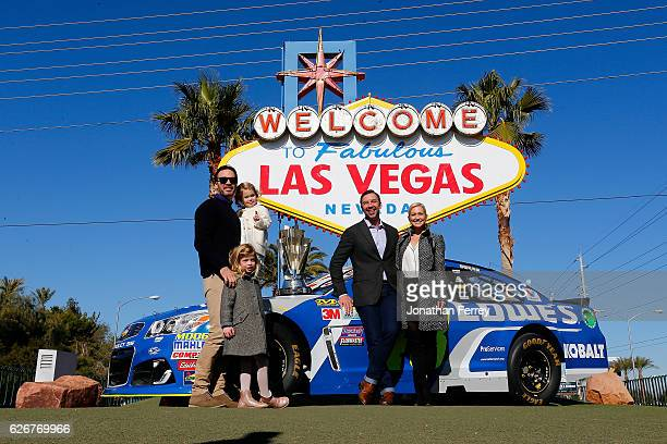 Sprint Cup Series champion Jimmie Johnson along with his daughters Genevieve Marie and Lydia Norriss Crew Cheif Chad Knaus and Brooke Werner pose for...