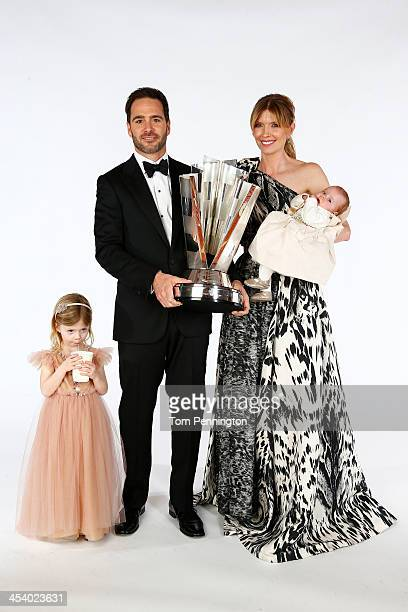 Sprint Cup Series Champion Jimmie Johnson his wife Chandra daughters Genevieve Marie and Lydia Norriss pose for a portrait prior to the NASCAR Sprint...
