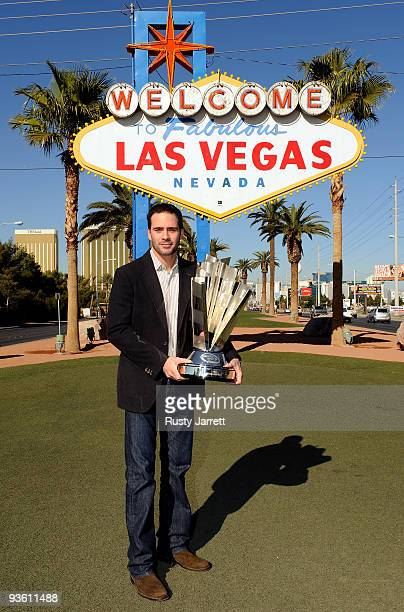 Sprint Cup Series Champion Jimmie Johnson poses with the trophy during Day 1 of the NASCAR Sprint Cup Series Champions Week on December 2 2009 in Las...