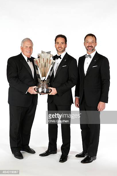 Sprint Cup Series Champion Jimmie Johnson team owner Rick Hendrick and crew chief Chad Knaus pose for a portrait prior to the NASCAR Sprint Cup...