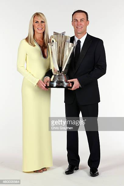 Sprint Cup Series Champion Kevin Harvick poses for a portrait with his wife DeLana during the 2014 NASCAR Sprint Cup Series Awards at Wynn Las Vegas...