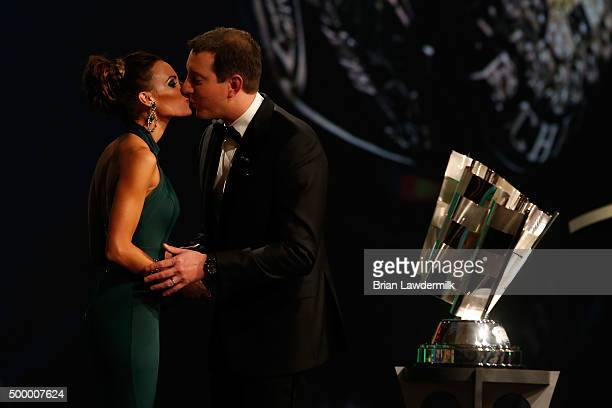 Sprint Cup Series Champion Kyle Busch and wife Samantha kiss onstage during the 2015 NASCAR Sprint Cup Series Awards show at Wynn Las Vegas on...