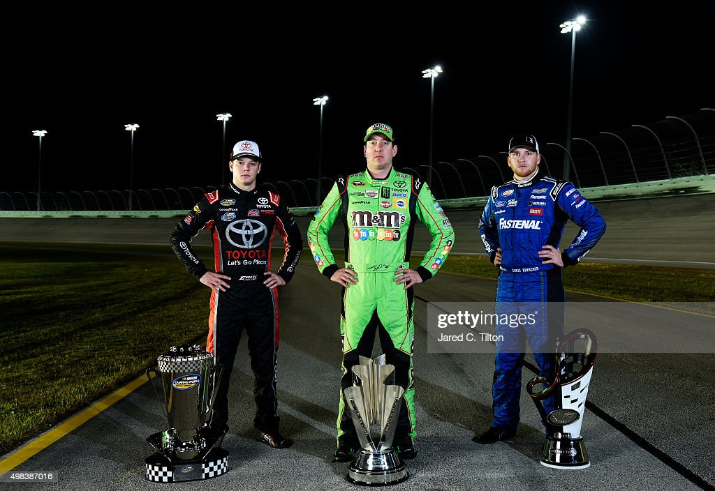 Sprint Cup Series champion Kyle Busch (C), driver of the #18 M&M's Crispy Toyota, NASCAR XFINITY Series champion Chris Buescher (R), driver of the #60 Fastenal Ford, and NASCAR Camping World Truck Series champion Erik Jones (L), driver of the #4 Toyota, pose for a portrait at Homestead-Miami Speedway on November 22, 2015 in Homestead, Florida.