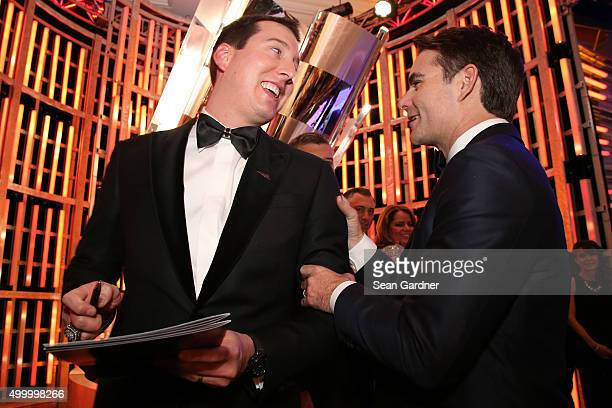Sprint Cup Series Champion Kyle Busch gets an autograph from Jeff Gordon during the 2015 NASCAR Sprint Cup Series Awards show at Wynn Las Vegas on...