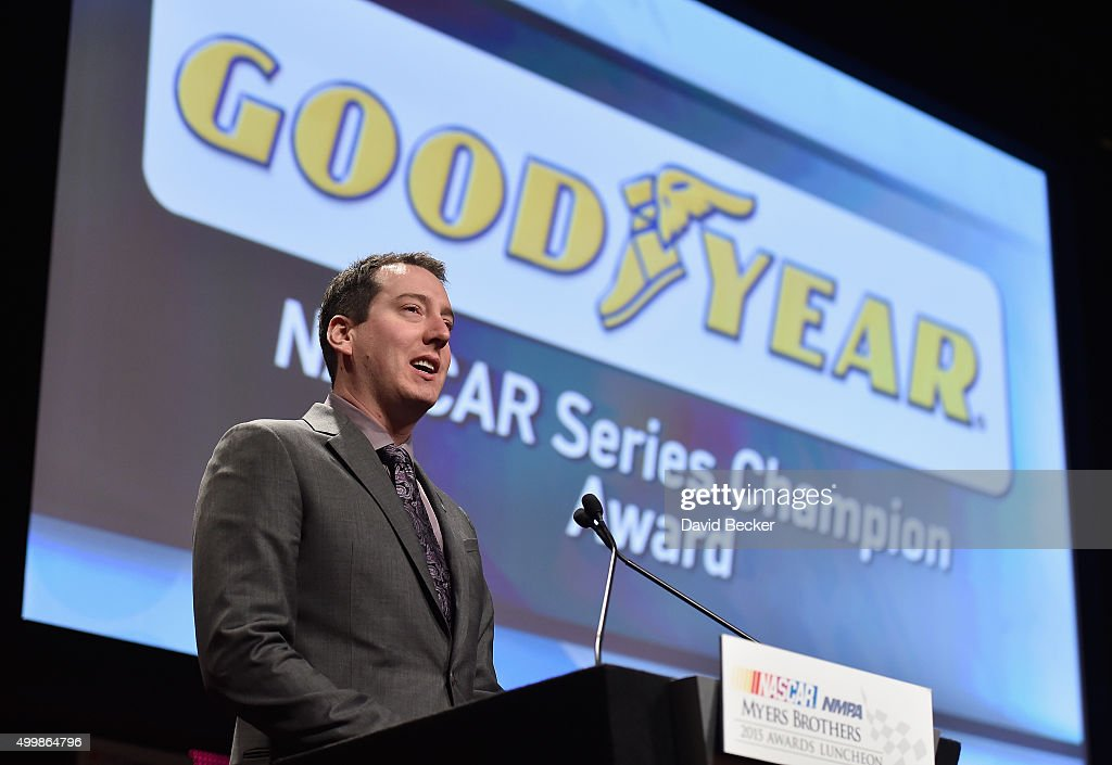 Sprint Cup Series Champion Kyle Busch reacts onstage during the 2015 NASCAR NMPA Myers Brothers Awards Luncheon at Encore Las Vegas on December 3, 2015 in Las Vegas, Nevada.