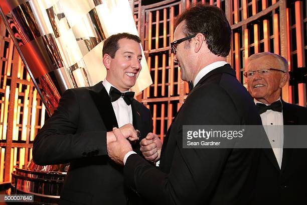 Sprint Cup Series Champion Kyle Busch talks with JD Gibbs during the 2015 NASCAR Sprint Cup Series Awards show at Wynn Las Vegas on December 4 2015...