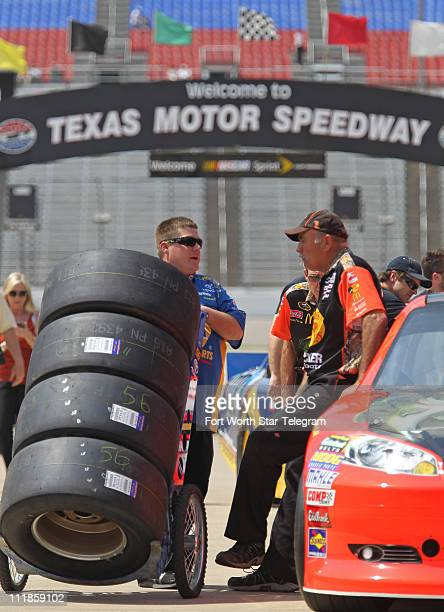 Sprint Cup Series crew members visit during a quiet time before practice on Thursday, April 7 at Texas Motor Speedway leading up to the O'Reilly Auto...
