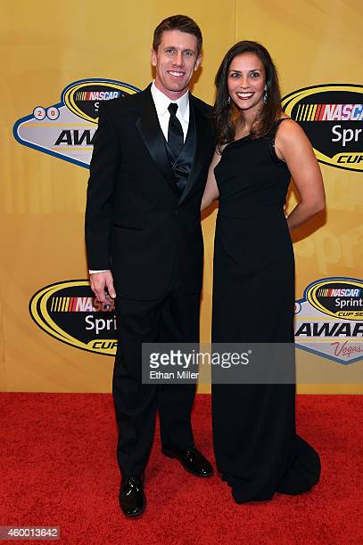 Sprint Cup Series driver Carl Edwards and his wife Dr Kate Edwards arrive on the red carpet prior to the 2014 NASCAR Sprint Cup Series Awards at Wynn...