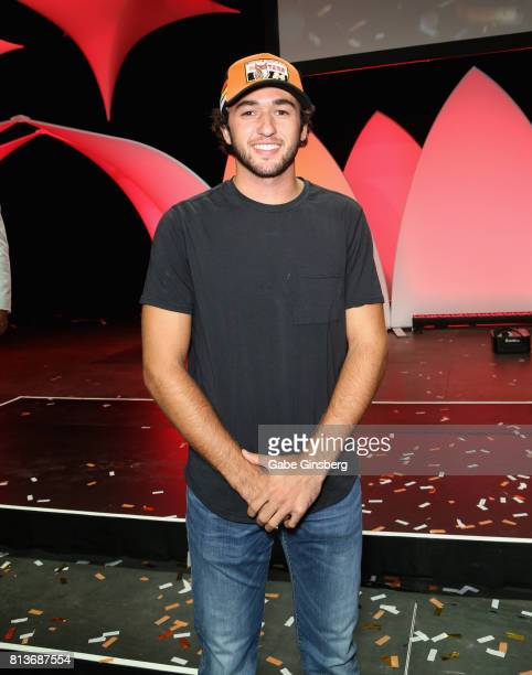 Sprint Cup series driver Chase Elliott poses after judging the 21st annual Hooters International Swimsuit Pageant at The Pearl concert theater at...