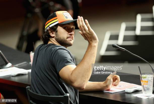 Sprint Cup series driver Chase Elliott waves while judging the 21st annual Hooters International Swimsuit Pageant at The Pearl concert theater at...