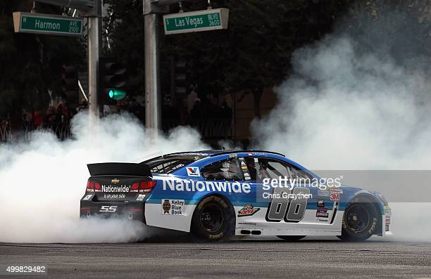 Sprint Cup Series driver Dale Earnhardt Jr performs a burnout during the NASCAR Victory Lap on the Las Vegas Strip on December 3 2015 in Las Vegas...