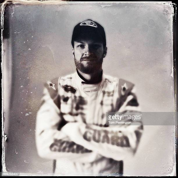 NASCAR Sprint Cup Series driver Dale Earnhardt Jr poses for a portrait during the 2014 NASCAR Media Day at Daytona International Speedway on February...