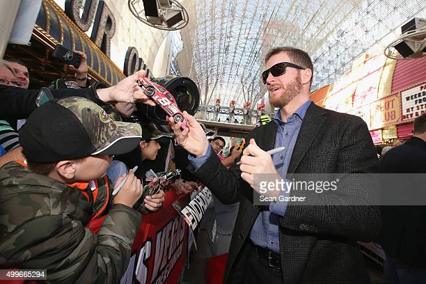 Sprint Cup Series driver Dale Earnhardt Jr signs autographs for fans during the NASCAR Sprint Cup Series FanFest hosted by Las Vegas Motor Speedway...