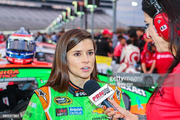 Sprint Cup Series driver Danica Patrick does an interview during practice for the NASCAR AAA Texas 500 at Texas Motor Speedway in Fort Worth TX